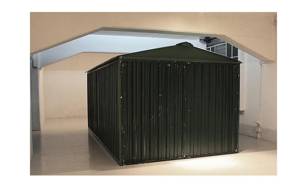 Fabio Sandri, Garage, 2010 - Prefabricated garage, video camera, projector, virgin photographic paper, printed contact photographs